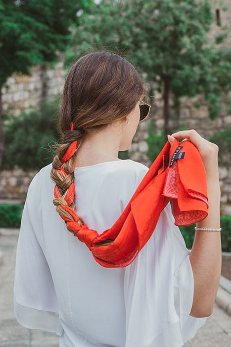 Woman with a braid made with a scarf
